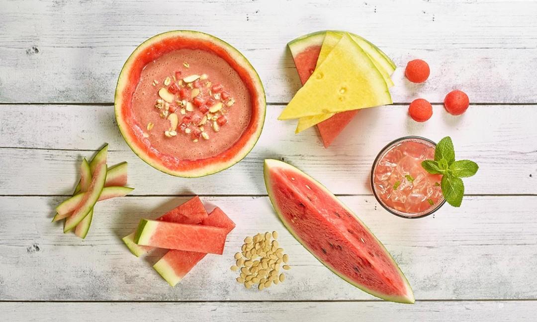 watermelon cuts, seeds, gazpacho on wooden background