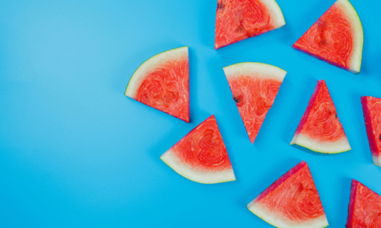 watermelon triangular cuts on right side of blue background