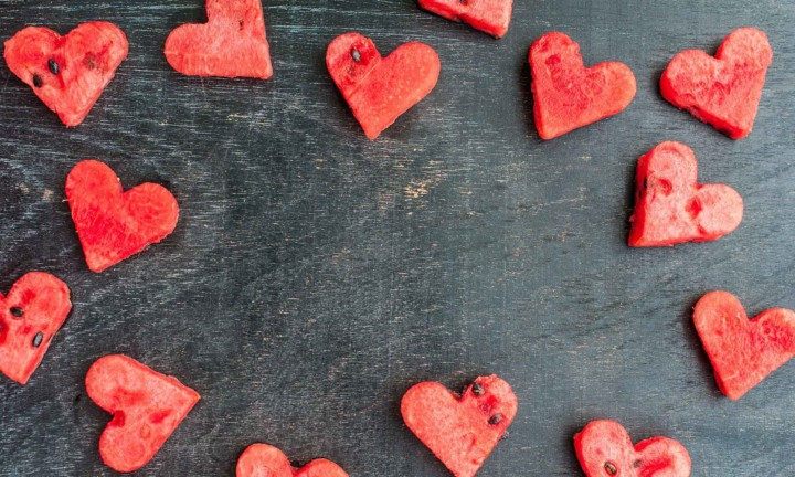 watermelon heart cutouts on black wooden table