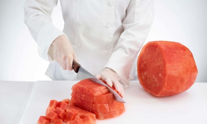 chef cutting flesh into chunks