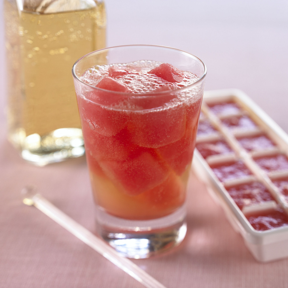 Watermelon ice cubes in a tray and in a beverage