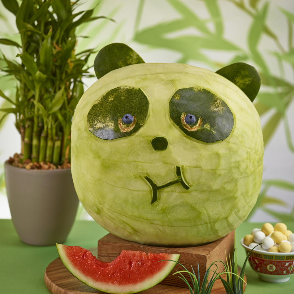 Watermelon carved like the head of a panda
