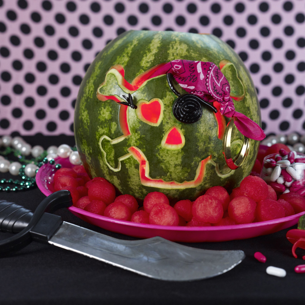 Pirate Girl Skull set on platter with watermelon balls around and treasure pieces and knife.