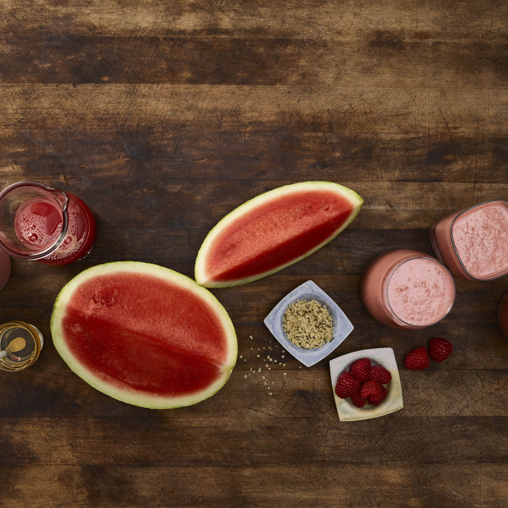 Overhead view of rosy red smoothie and ingredients