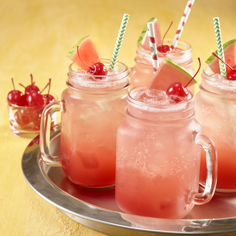 Shirley temples in jar glasses on a tray