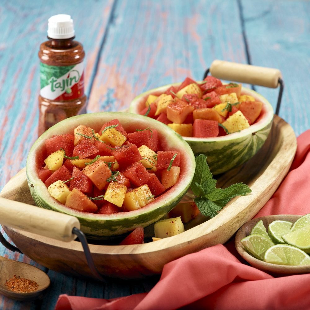 Tajin fruit salad served in hollowed out mini watermelons