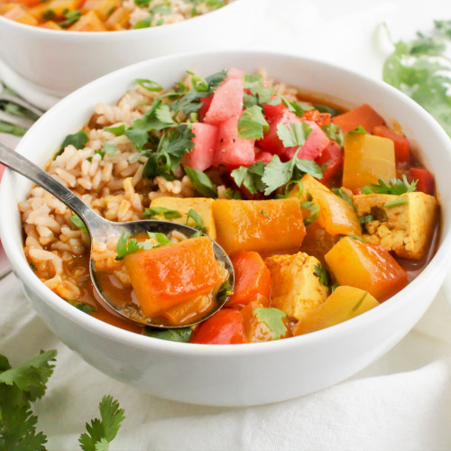 rind curry in bowl with garnish of parsley and watermelon chunks