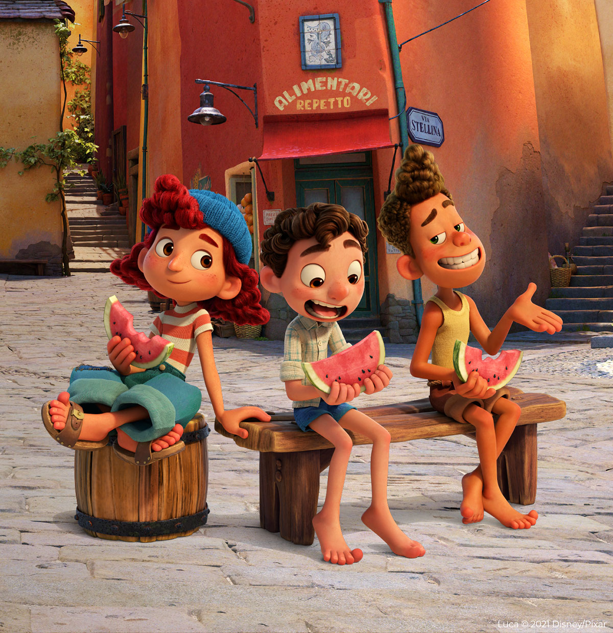 Disney Pixar's Luca characters Giulia, Luca and Alberto sitting on a bench eating watermelon in the town of Portorosso.